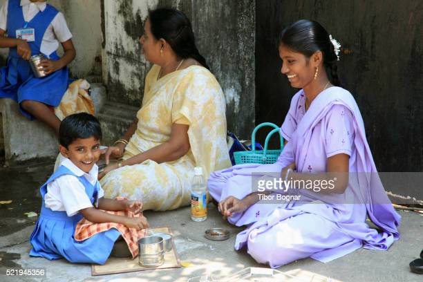 india, puducherry, pondicherry, mother with schoolchildren at lunch - tamil nadu stock pictures, royalty-free photos & images
