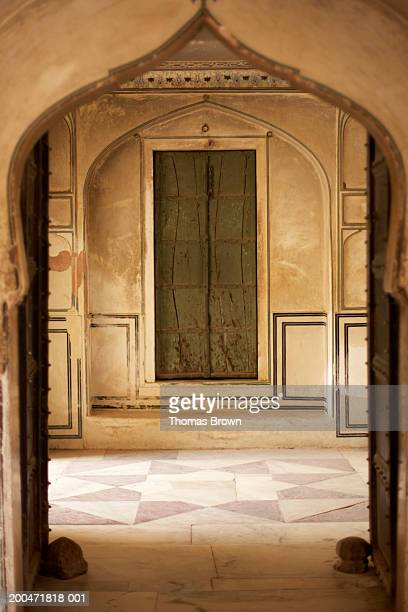 India, Rajasthan, Amber Fort, painted door, view through archway
