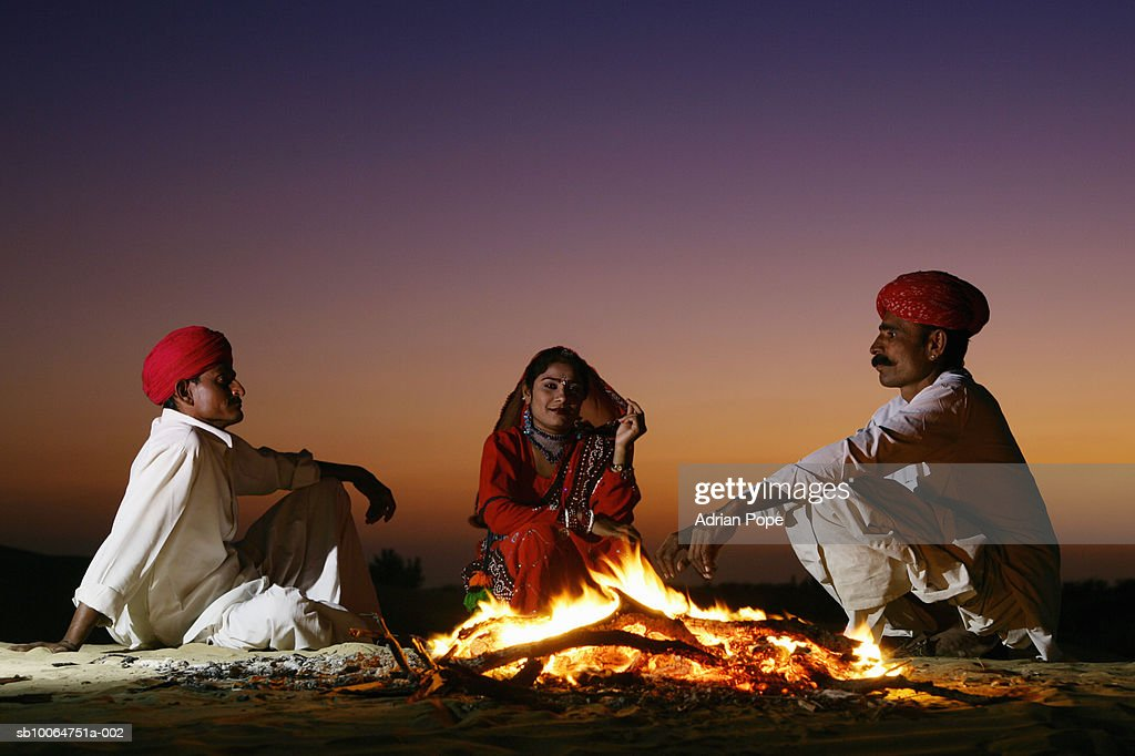 India Rajasthan Jaiselmer Rajput Tribesmen And Woman By Campfire At