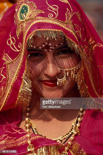 India Rajasthan Jhunjhunu Head and shoulders portrait of a female dancer in traditional dress before the start of the Shekhawati Festival