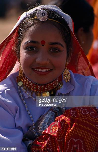 India Rajasthan Jhunjhunu Portrait of a young girl dancer smiling wearing traditional dress and jewelry before the start of the Shekhawati Festival