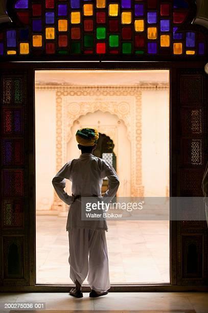 india, rajasthan, jodhpur, meherangarh fort, guard, rear view - meherangarh fort stock photos and pictures