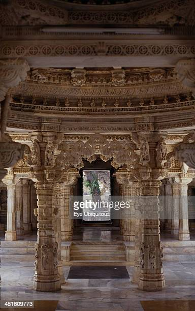 India Rajasthan Mount Abu Dilwara Temple complex dating from 11th13th century AD Detail of intricately carved white marble ceiling and supporting...