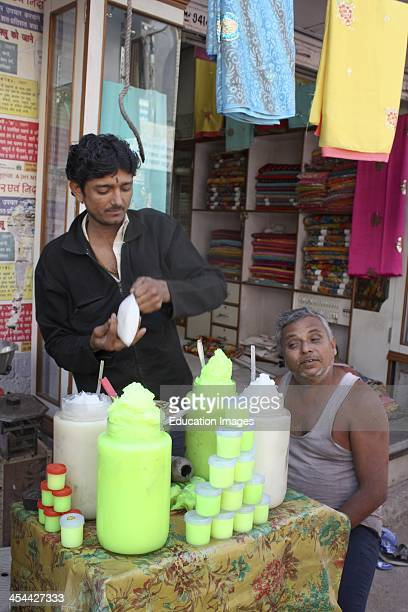 India, Rajasthan state Jodhpur, Bazaar Stall selling green colored Vaseline.