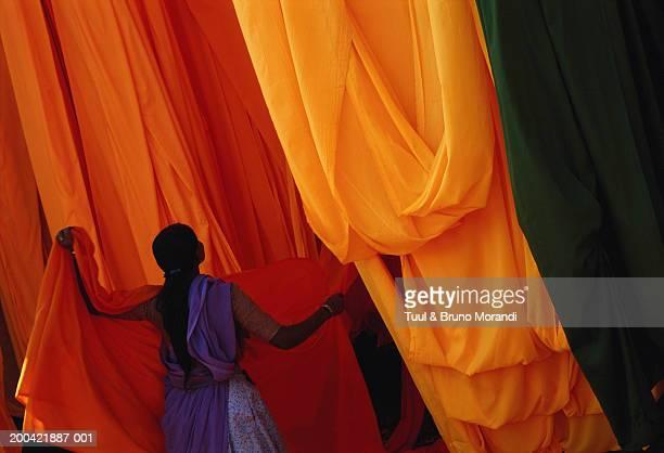 India, Rajasthan, woman in sari factory
