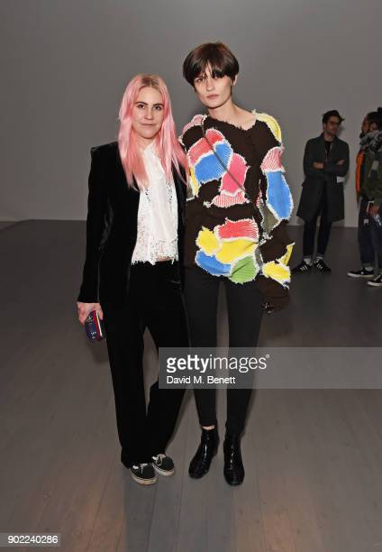 India Rose James and Lara Mullen attend the Alex Mullins show during London Fashion Week Men's January 2018 at BFC Show Space on January 7 2018 in...