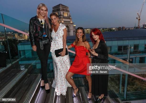India Rose James Laura Pradelska Lara Fraser and Nikita Andrianova attends the opening of new rooftop bar Savage Garden on June 27 2018 in London...