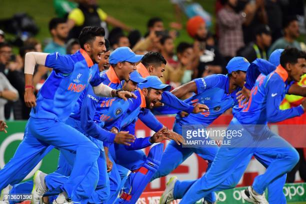 India run out onto the pitch as they celebrate their win in the U19 cricket World Cup final match between India and Australia at Bay Oval in Mount...