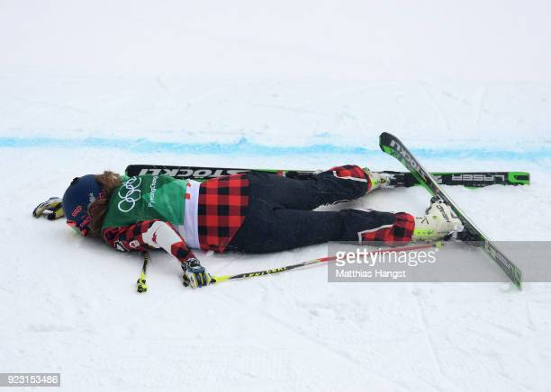 India Sherret of Canada lies on the snow after crashing during the Freestyle Skiing Ladies' Ski Cross 1/8 Finals on day fourteen of the PyeongChang...