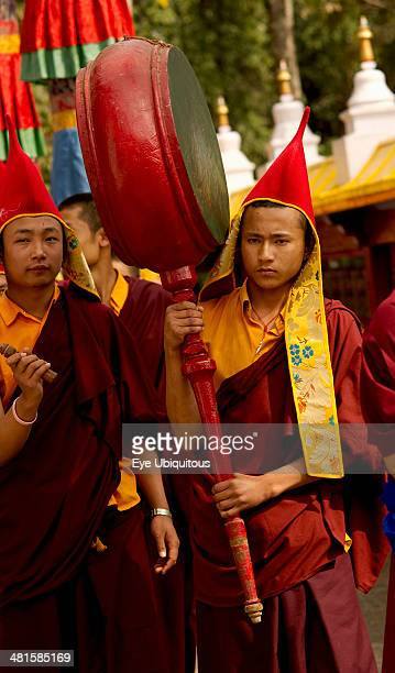 India Sikkim Buddhist Monk playing a drum in a Losar ceremonial procession