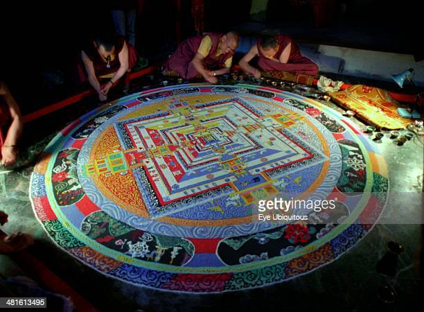 India Sikkim Rumtek Gompa Several monks painting decorative patterns for the Pujar ceremony and the making of a spiritual Mandala