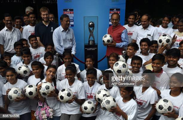 India Sports Minister Vijay Goel poses with the FIFA U17 World Cup 2017 trophy alongwith underpriviledged children during a promotional event in New...