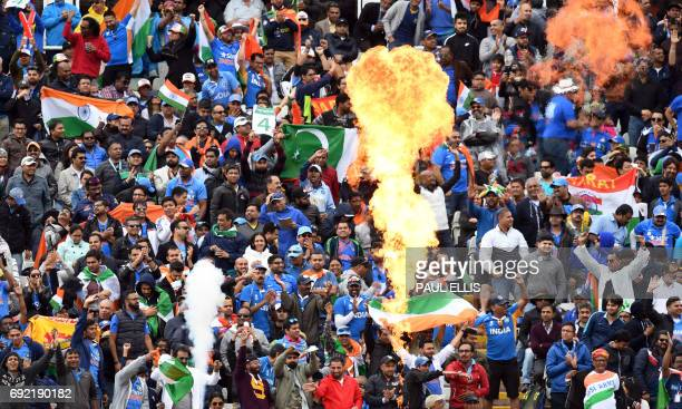 India supporters celebrate a four during the ICC Champions trophy match between India and Pakistan at Edgbaston in Birmingham on June 4 2017 / AFP...