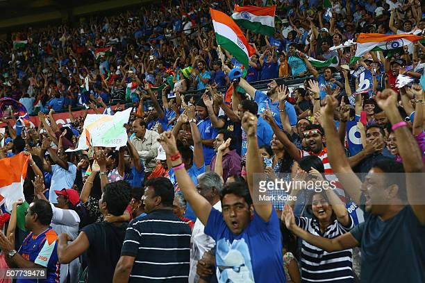 India supporters cheer as they celebrate victory during the International Twenty20 match between Australia and India at Sydney Cricket Ground on...