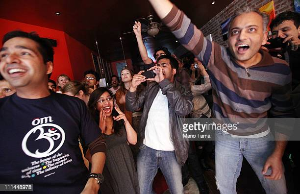 India supporters cheer in Manhattan's JujoMukti Tea Lounge at the conclusion of the 2011 Cricket World Cup as India defeated Sri Lanka on April 2...