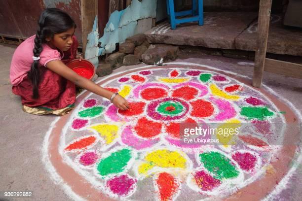 India Tamil Nadu Kumbakonam A girl making a rangoli to celebrate the Pongal festival