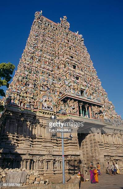 India Tamil Nadu Madurai Sri Meenakshi temple exterior with group of people outside entrance