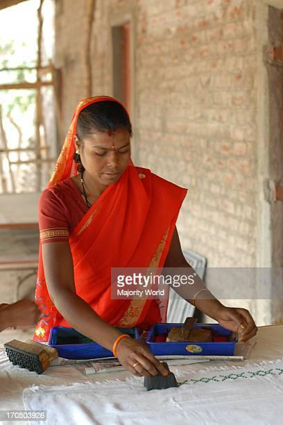 The cloth produced by the women's self help group is handed over to another set of women who then do block printing on it 07Mar07