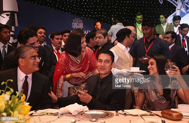 India Today group chairman Aron Purie with actor Aamir Khan and Asin Thottukmal at the dinner party hosted after the India Today Conclave ended in...