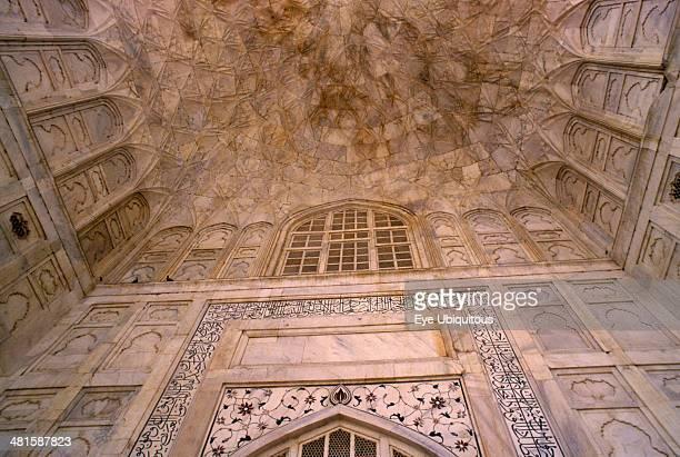 India Uttar Pradesh Agra Taj Mahal built 16311653 Interior detail of marble walls and ceiling inlaid with semiprecious stones using process known as...