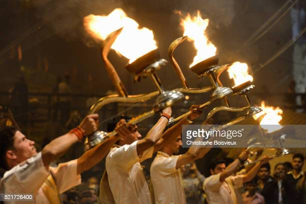 india, uttar pradesh, varanasi, aarti, offering of light to the ganges - brahmin stock pictures, royalty-free photos & images