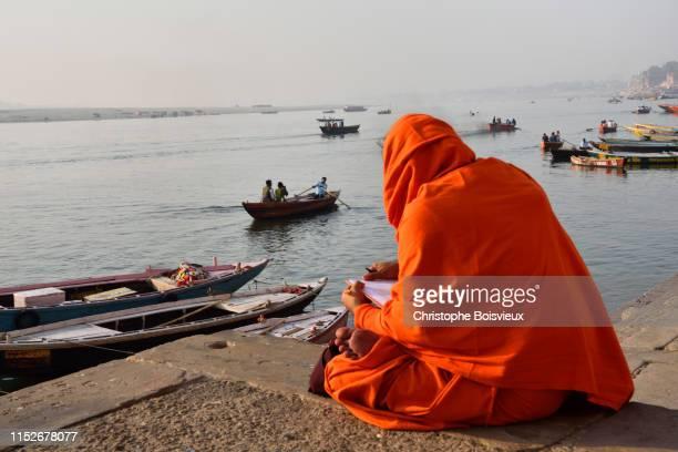 india, uttar pradesh, varanasi, ascetic reading sacred texts. - uttar pradesh stock pictures, royalty-free photos & images