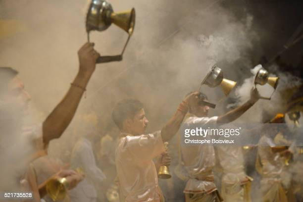 India, Uttar Pradesh, Varanasi, Offering of incense to the Ganges