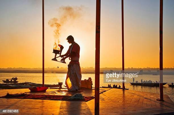 India Uttar Pradesh Varanasi Performing the Ganga Aarti Ceremony at dawn over the River Ganges