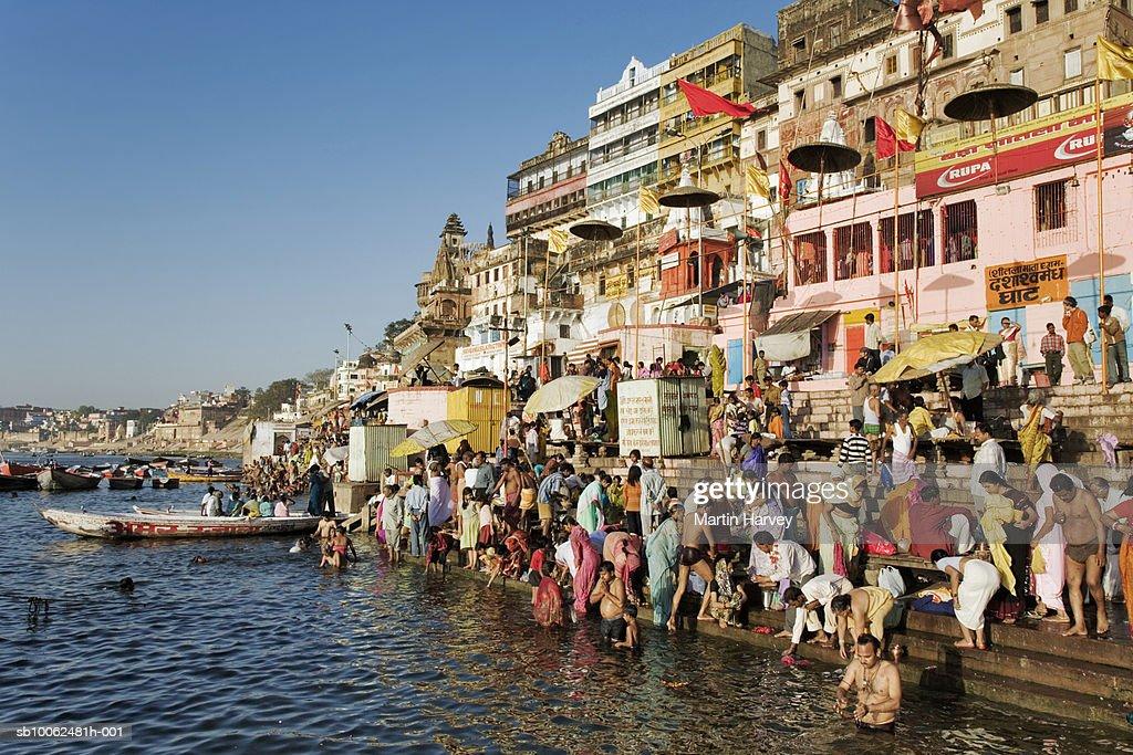 India, Varanasi, Ganges River, pilgrims on ghats : Stock Photo