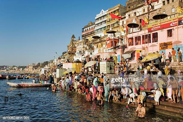 india, varanasi, ganges river, pilgrims on ghats - ganges river stock pictures, royalty-free photos & images