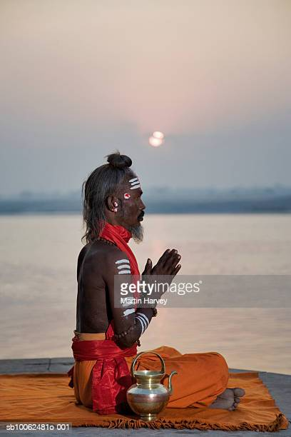 India, Varanasi, Ganges River, sadhu performing puja