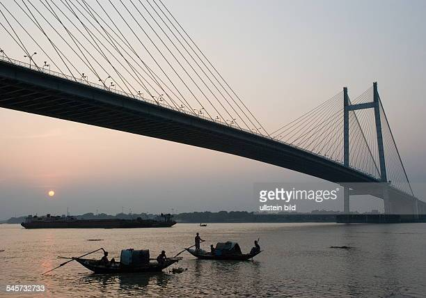 India West Bengal Kolkata Second Hooghly Bridge over river Hooghly with country fishing boats 2010