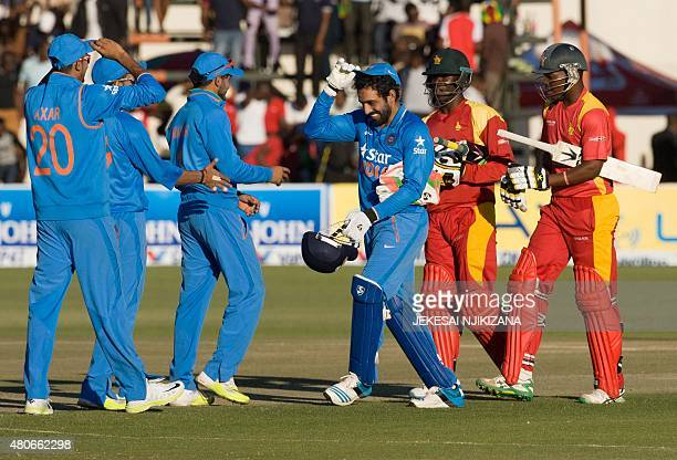 India wicket keeper Robin Uthappa celebrates victory with team mates at the end of the third and final game in a series of 3 ODI cricket matches...