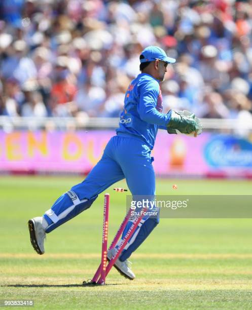 India wicketkeeper MS Dhoni catches out Eoin Morgan before treading onto the stumps during the 3rd Vitality International T20 match between England...