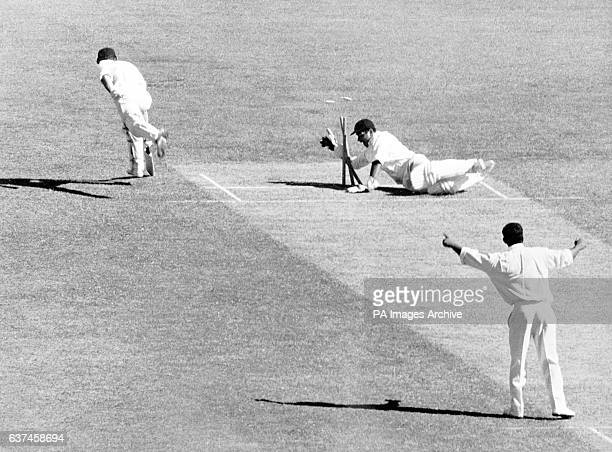 India wicketkeeper Farokh Engineer breaks the wicket in a vain bid to run out Victoria's Ian Redpath