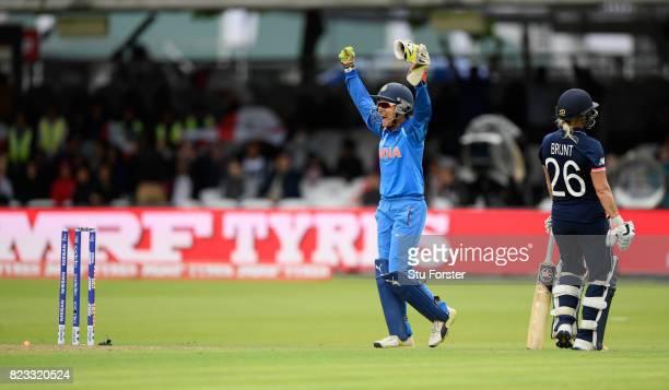 India wicketkeeper Sushma Verma celebrates after Kathryn Brunt is run out during the ICC Women's World Cup 2017 Final between England and India at...