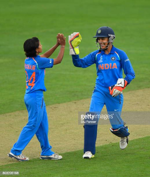 India wicketkeeper Sushma Verma celebrates with bowler Poonam Yadav after stumping West Indies batsman Merissa Aguilleira during the ICC Women's...