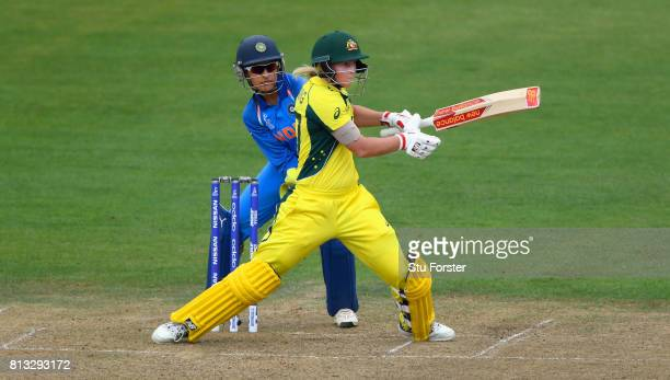 India wicketkeeper Sushma Verma looks on as Australia batsman Meg Lanning hits out during the ICC Women's World Cup 2017 match between Australia and...