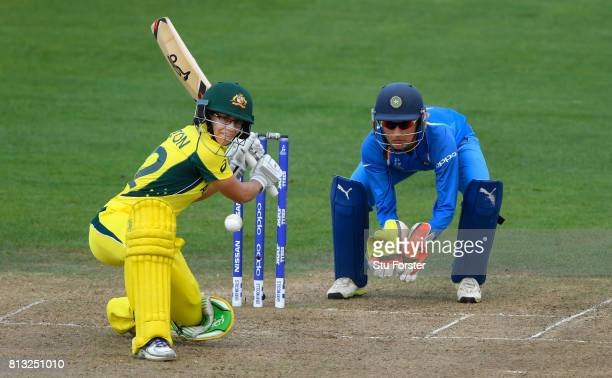 India wicketkeeper Sushma Verma looks on as Australia batsman Nicole Bolton hits out during the ICC Women's World Cup 2017 match between Australia...