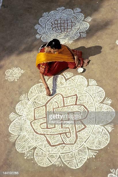 India Woman Painting Rangoli Design For Diwali Festival