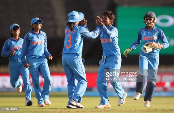 India Women's Deepti Sharma celebrates with Mithali Raj and teammates after bowling Australia Women's Alex Blackwell to win the ICC Women's World Cup...
