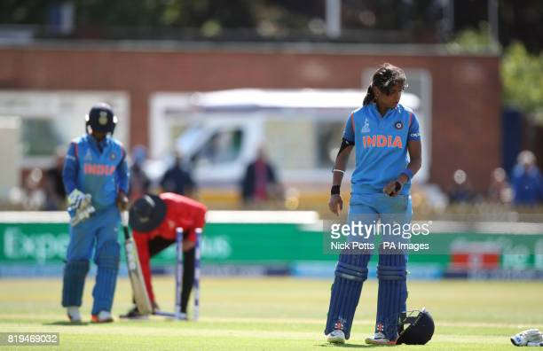 India Women's Harmanpreet Kaur reaches her century but exchanges words with Deepti Sharma after a mixup running between the wickets during the ICC...