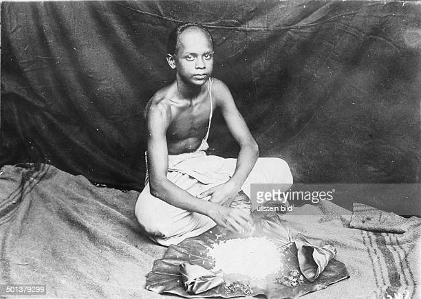 India young brahmin eating rice probably in the 1910s