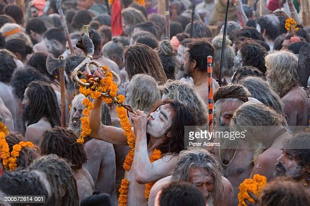 india,allahabad,kumbh mela festival,naga sadhus returning from bathing - prayagraj stock pictures, royalty-free photos & images