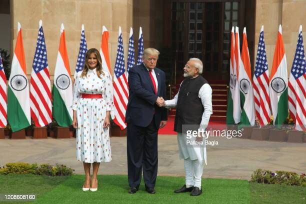 IndiaAmerica Summit left to right Mrs Melania Trump Mr Donald Trump and Mr Narendra Modi step out for a traditional handshake before they sat down...