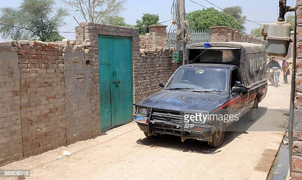 IndiaattackstrialPakistan by Waqar Hussain Pakistani policemen patrol at the assumed house of the alleged surviving gunman of the Mumbai massacre...
