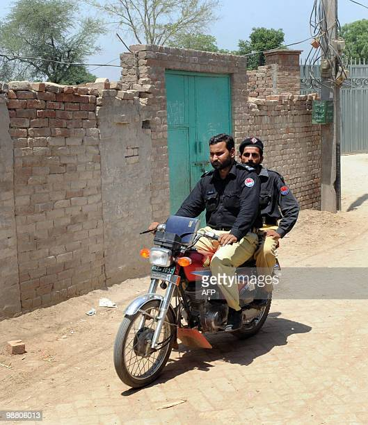 IndiaattackstrialPakistan by Waqar Hussain Pakistani policemen ride on a motorcycle as they patrol beside the assumed house of the alleged surviving...