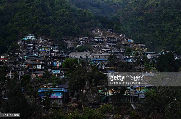 IndiaclimatetravelnaturerainGuinnessFEATURE by Ammu Kannampilly In this photograph taken on February 3 some homes appear with their lights on in the...