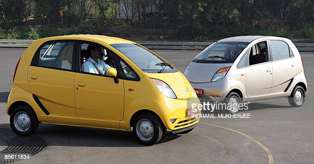 IndiacompanyautoTataNanoSCENE by Phil Hazlewood A Tata Motors employee drives a Nano car as he parks ahead of a test drive session for journalists at...