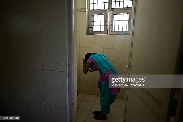 IndiacrimesocialtraffickingchildrenFEATURE by Trudy Harris In this photograph taken on September 16 an alleged Indian humantrafficking victim washes...